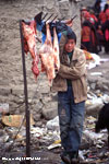 Boy selling goat meat